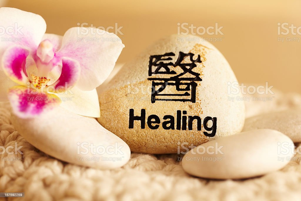 Still life of rock with healing in Japanese script royalty-free stock photo