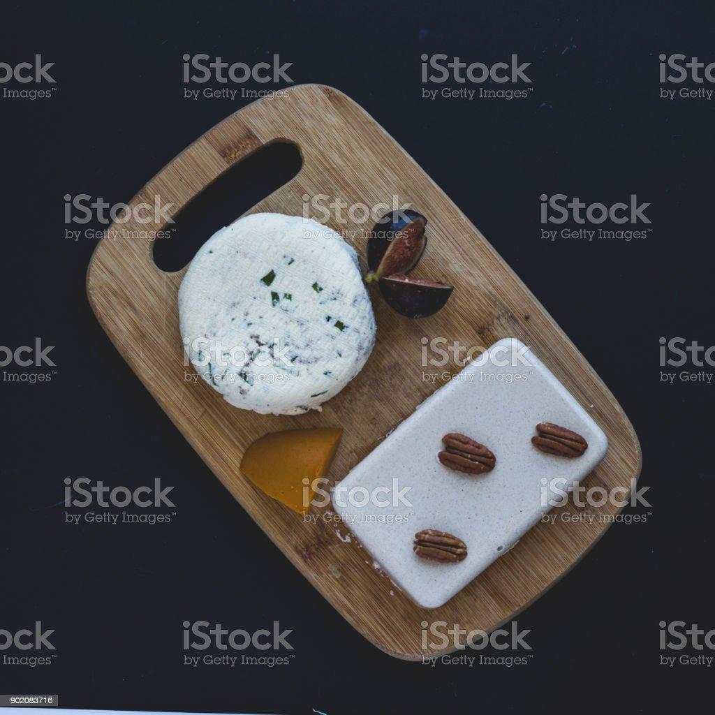 Still life of vegan cheeses stock photo