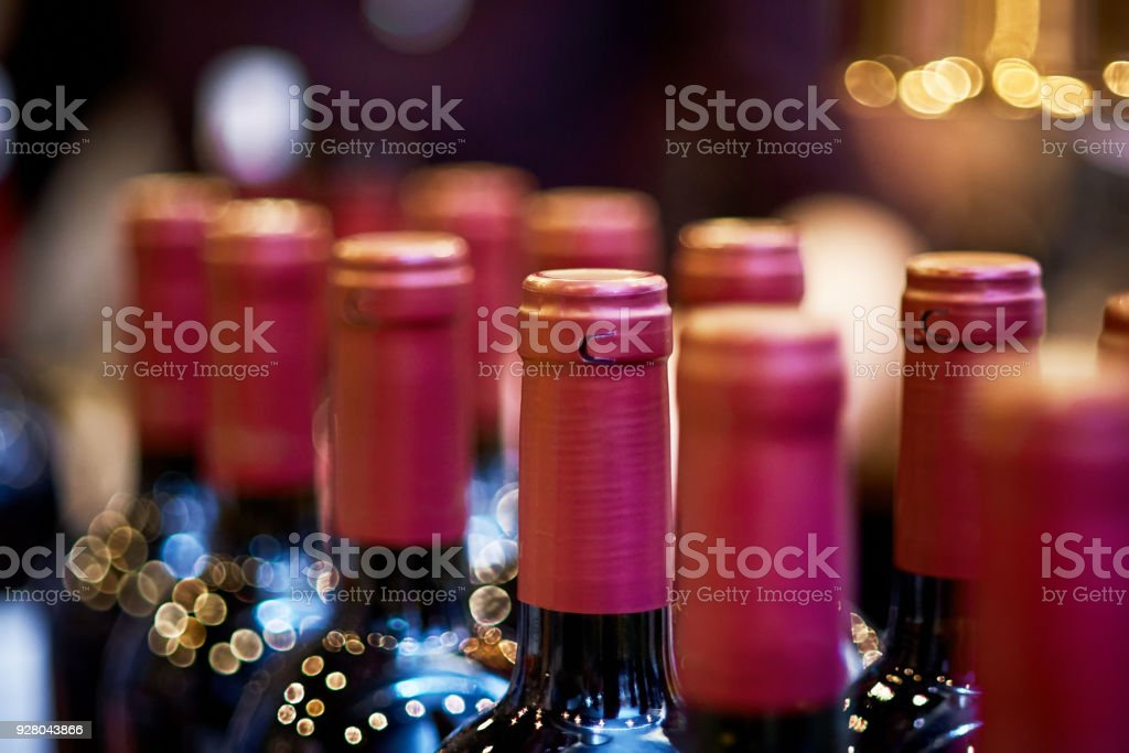 Still life of wine bottles with soft lighting and shallow dof. stock photo