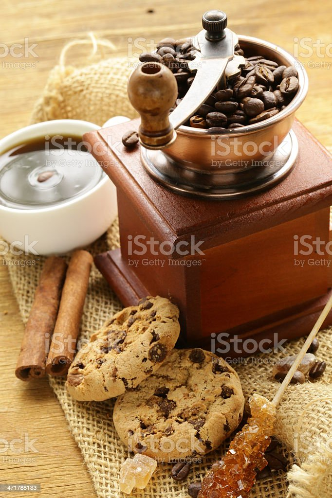 Still life of wooden coffee grinder, sugar, biscuits royalty-free stock photo