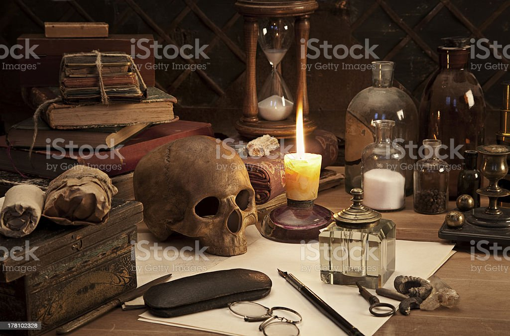 A still life photo of an alchemist's desk stock photo