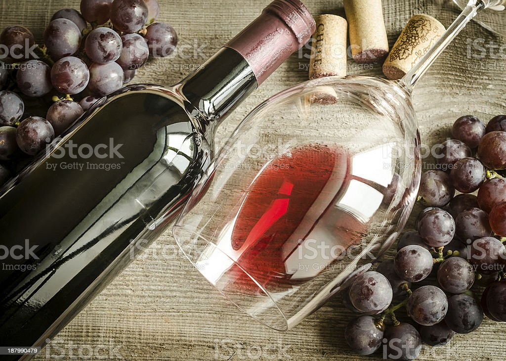 Still life photo of grapes, wine bottle and wine glass stock photo