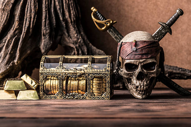 still life photography with pirate skull - pirates stock photos and pictures