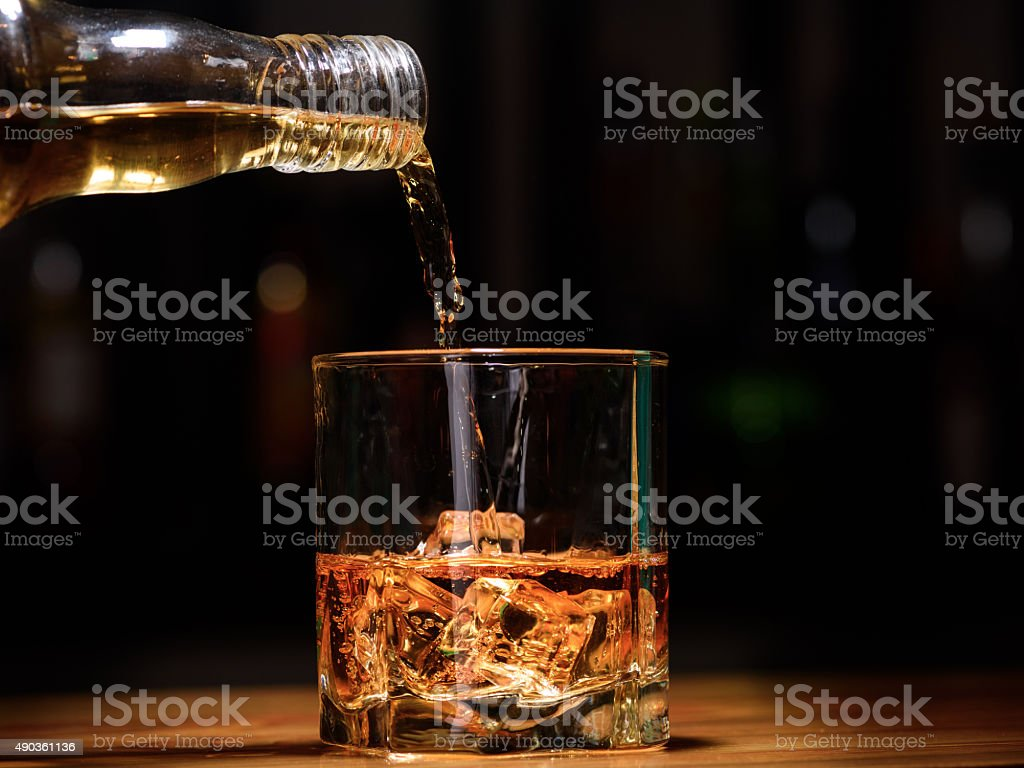 Still life. pour or whiskey in to glass stock photo