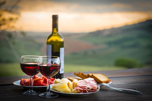 still life Red wine  ,cheese and prosciutto