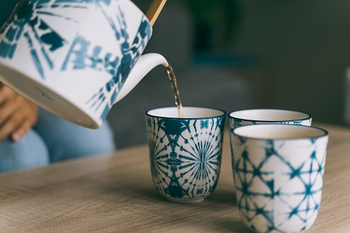 still life shoot with Asian teapot and cups