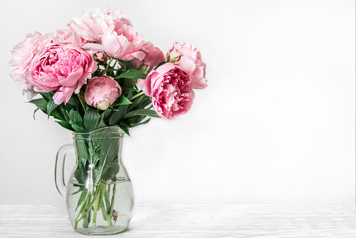 Still life with a beautiful bouquet of pink peony flowers. holiday or wedding background