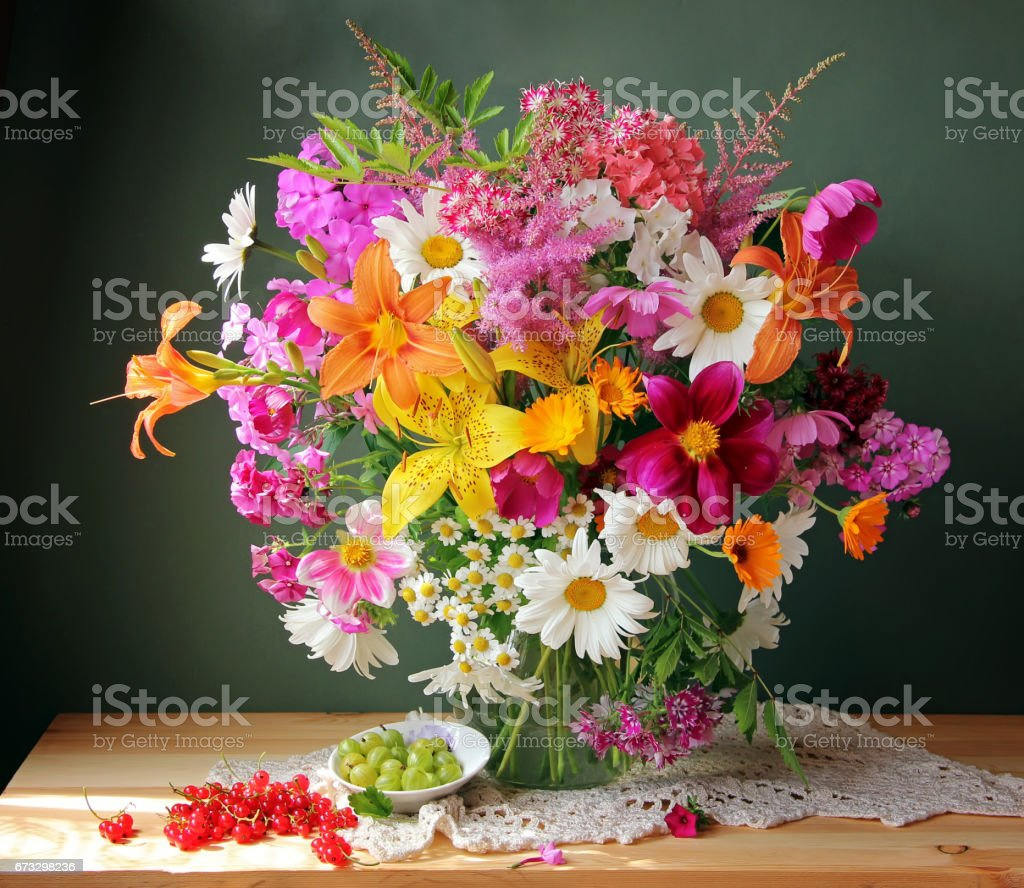 Still life with a bouquet of lilies and phloxes. royalty-free stock photo