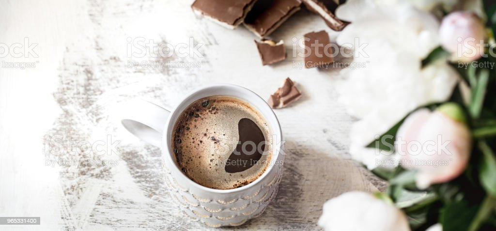 Still life with a cup of coffee and flowers royalty-free stock photo