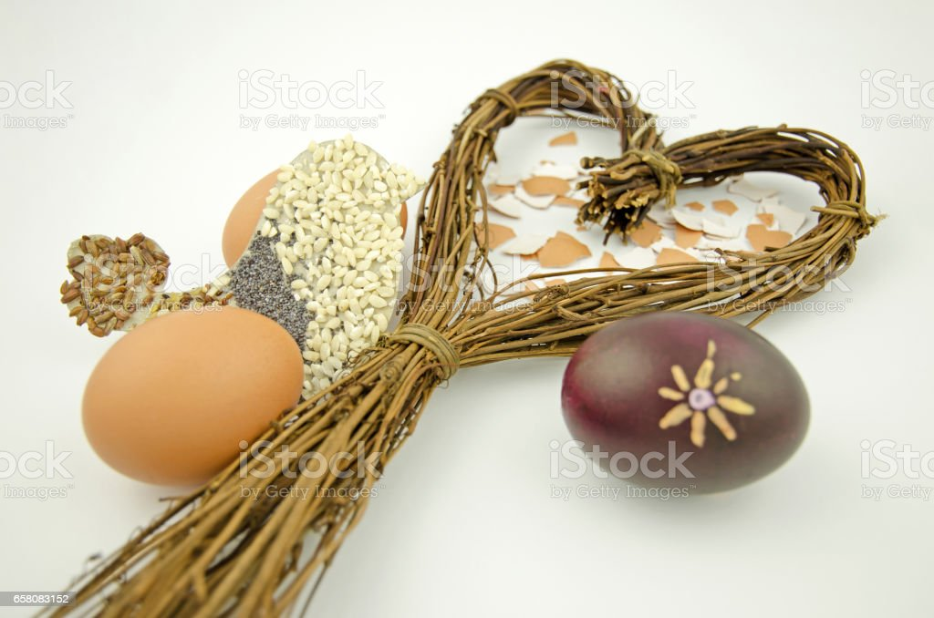 Still life with a heart of willow, Easter eggs and bird silhouette isolated on white background royalty-free stock photo
