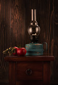 Still life with a vintage kerosene oil lamp and apples