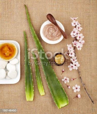istock Still life with aloe vera, honey, sugar scrub and flower 155148450