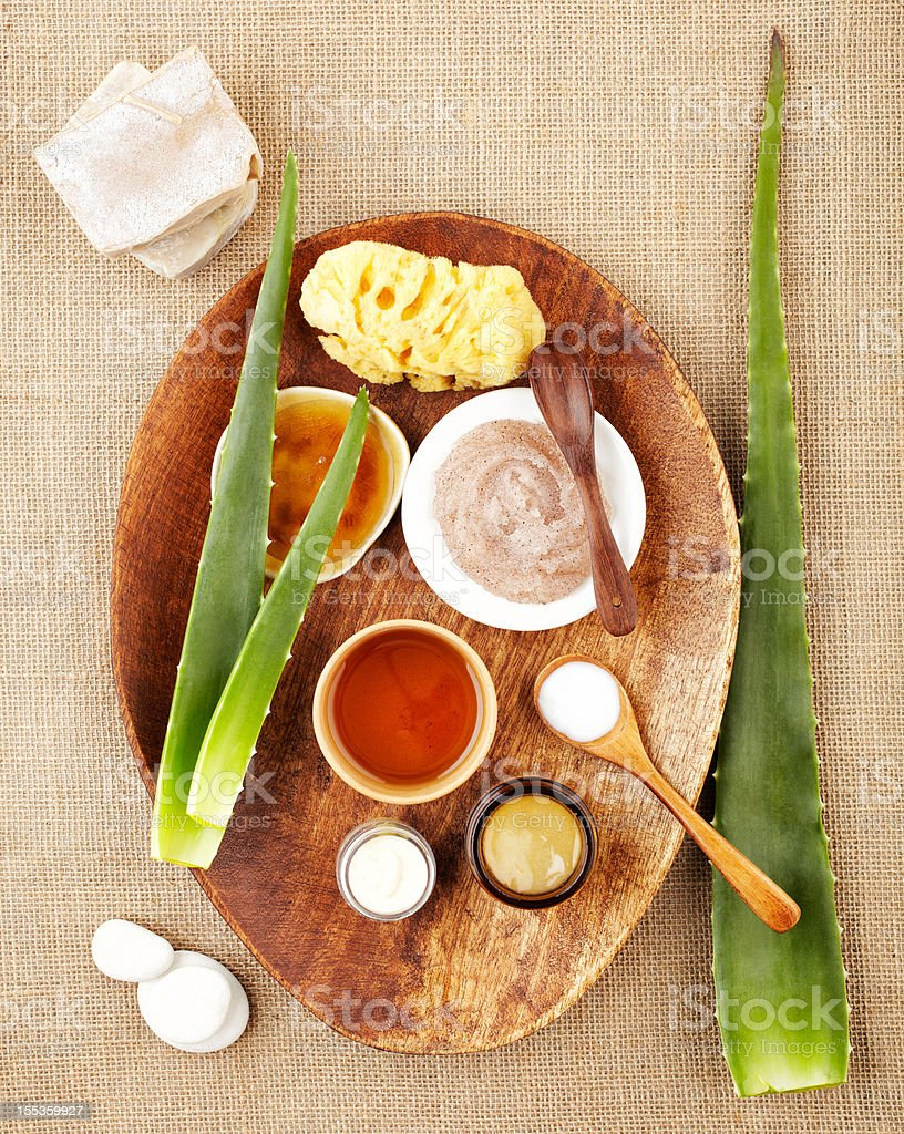 Still life with aloe vera, sugar scrub, honey stock photo
