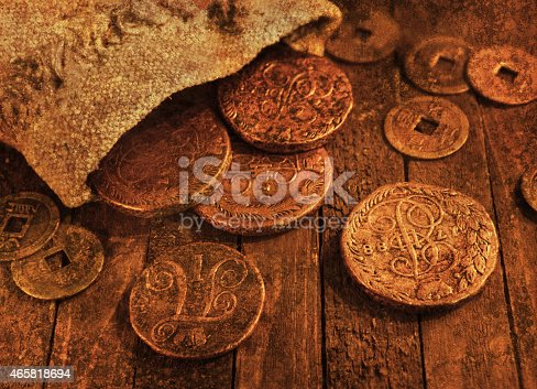 istock Still life with ancient coins, grunge texture effect 465818694