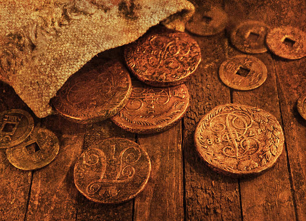Still life with ancient coins, grunge texture effect stock photo
