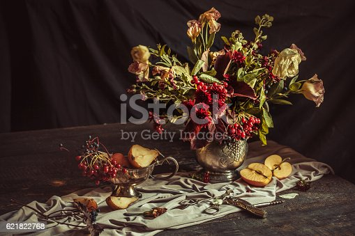 istock Still life with apples and autumn flowers 621822768
