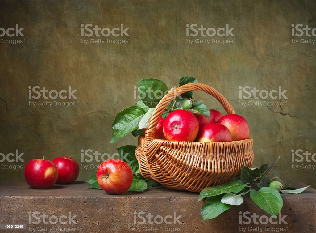 Still life with apples in a basket stock photo