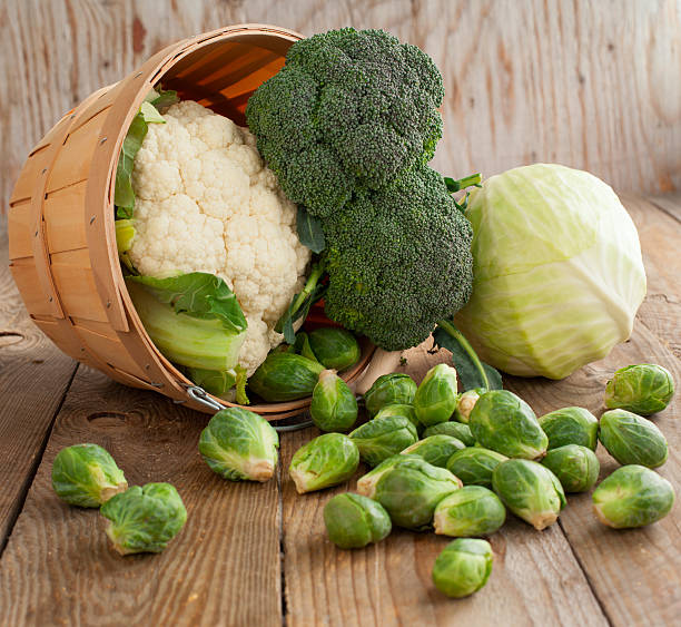 still life with assortment cabbages on wooden background - kruisbloemenfamilie stockfoto's en -beelden