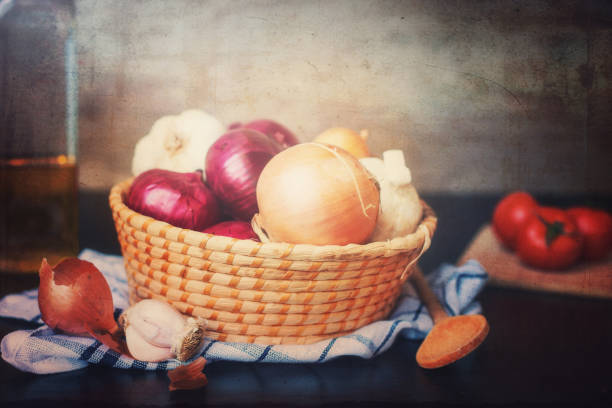 Still life with basket full of onions stock photo