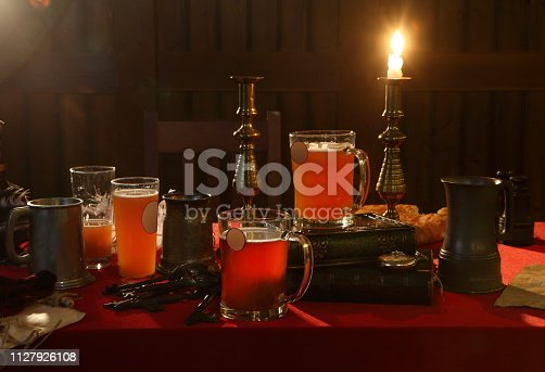 istock Still life with beer in old iron mugs 1127926108