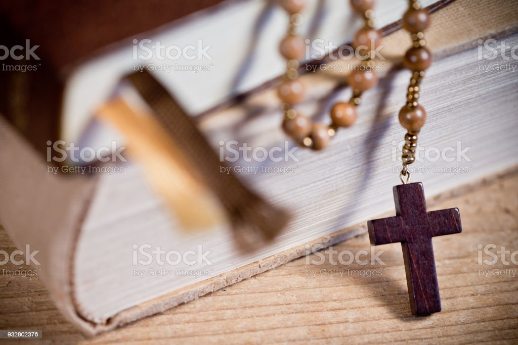 Still Life with Bible And Old Wooden Rosary stock photo