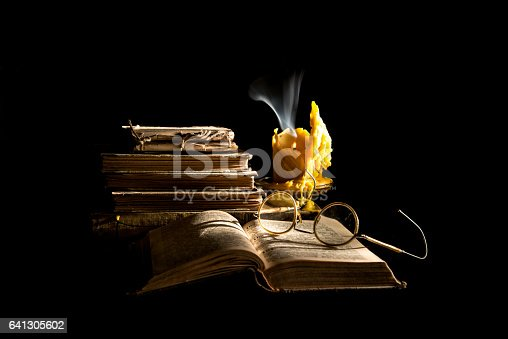 istock Still life with book, candle and glasses 641305602
