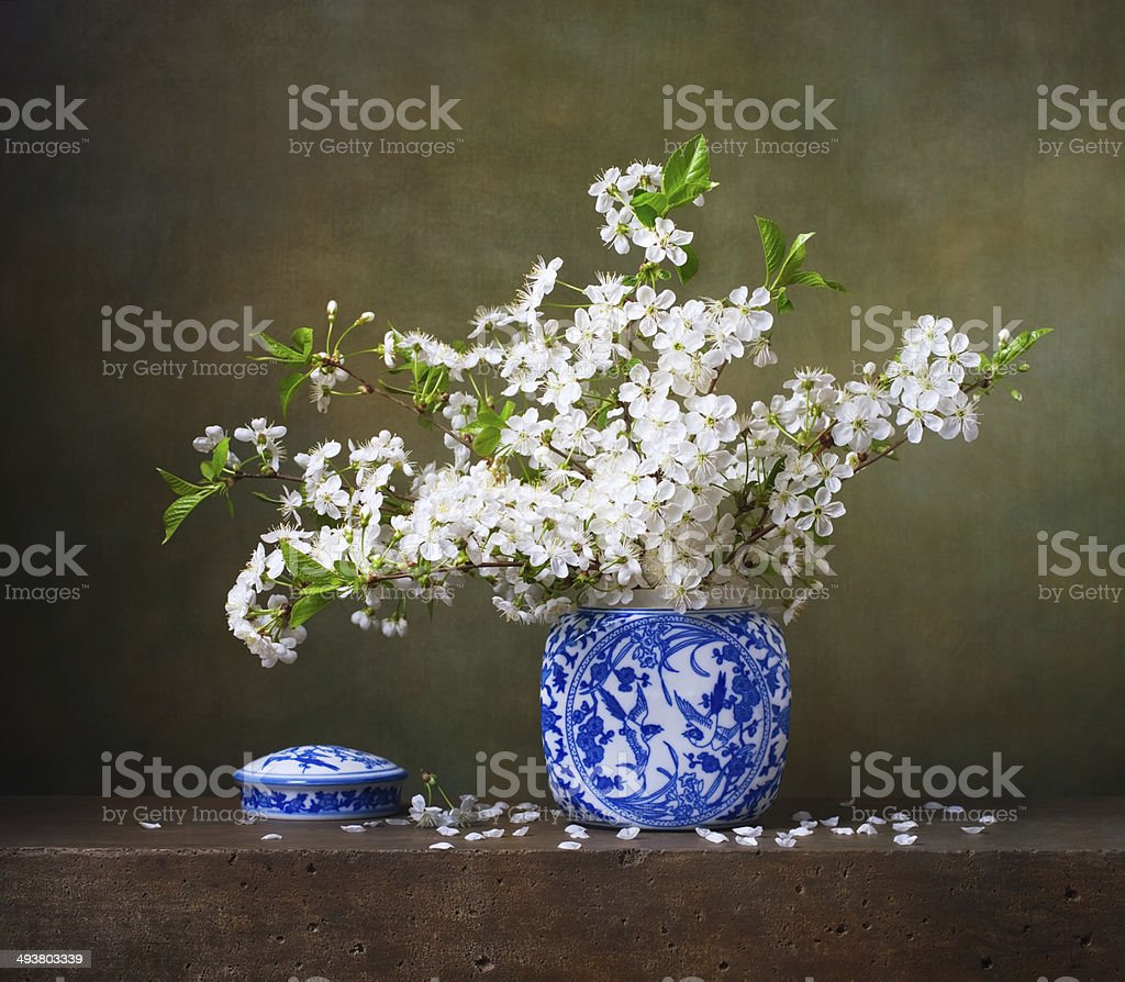 Still life with bouquet of cherry blossoms stock photo