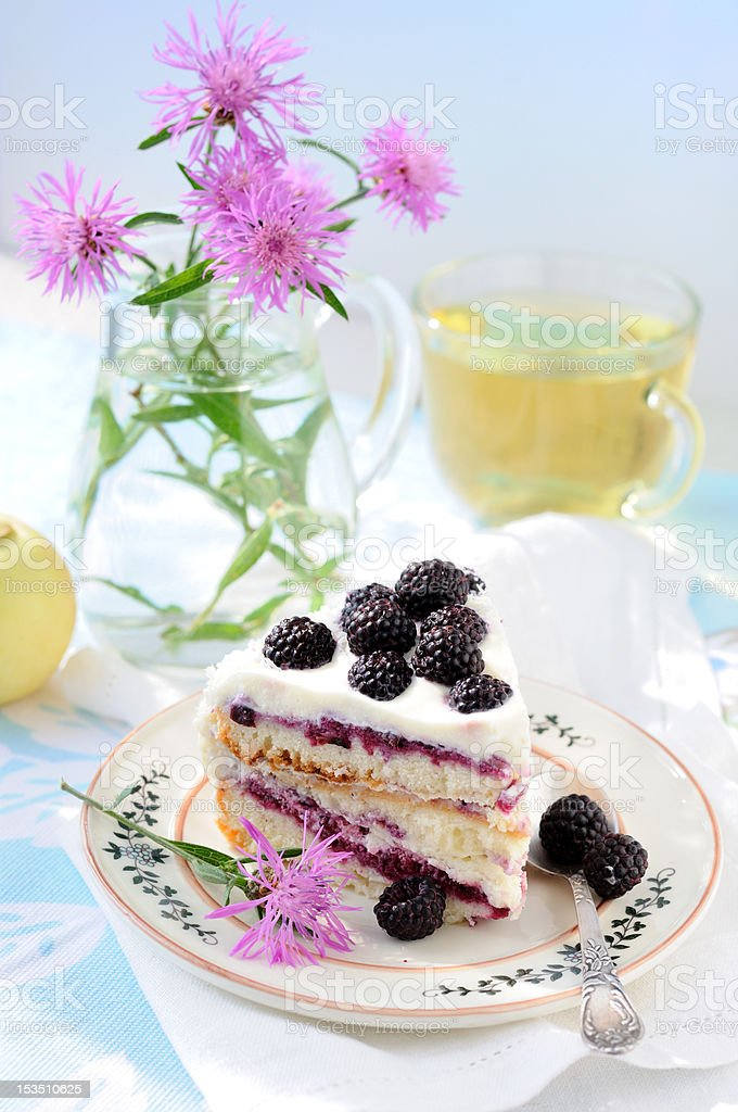 Still life with cake and cornflowers stock photo