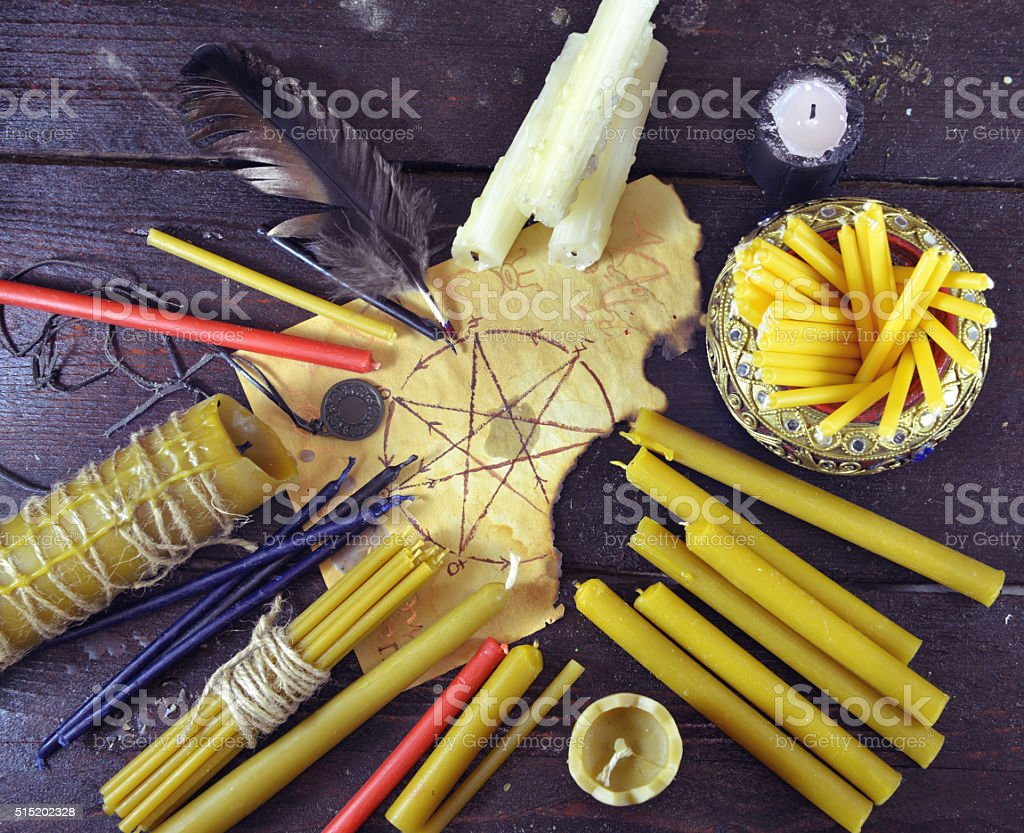 Still life with candles and manuscript with pentagram stock photo