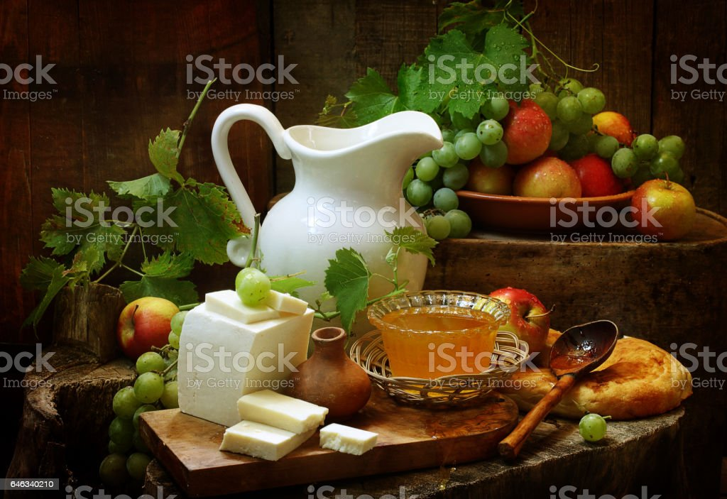 Still life with cheese, honey and fruit stock photo