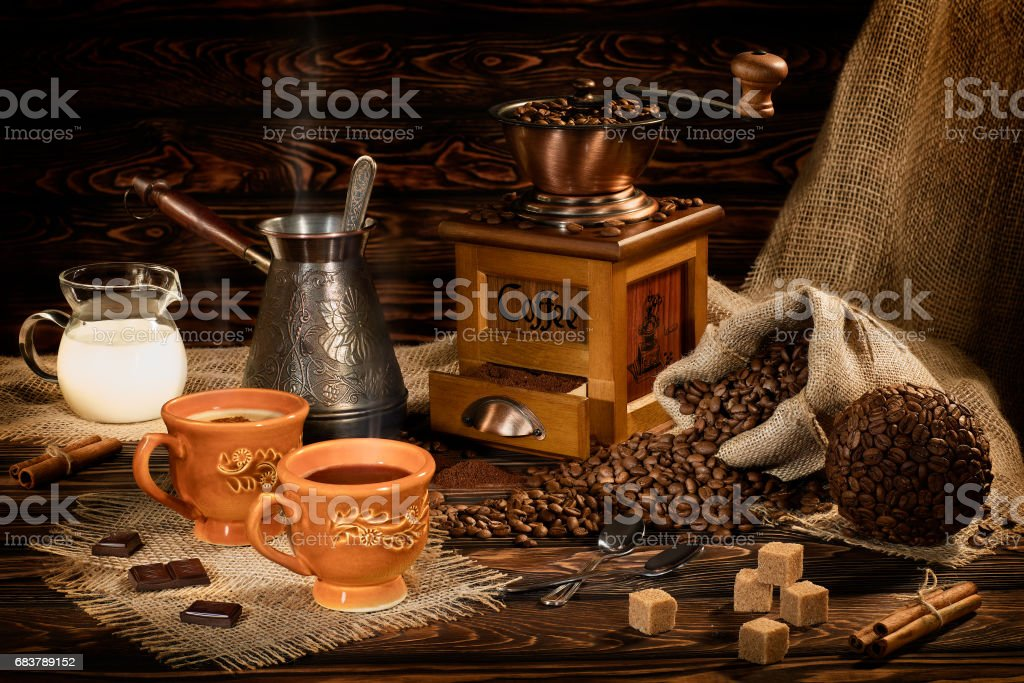 still life with coffee beans old coffee mill on wooden stock photo