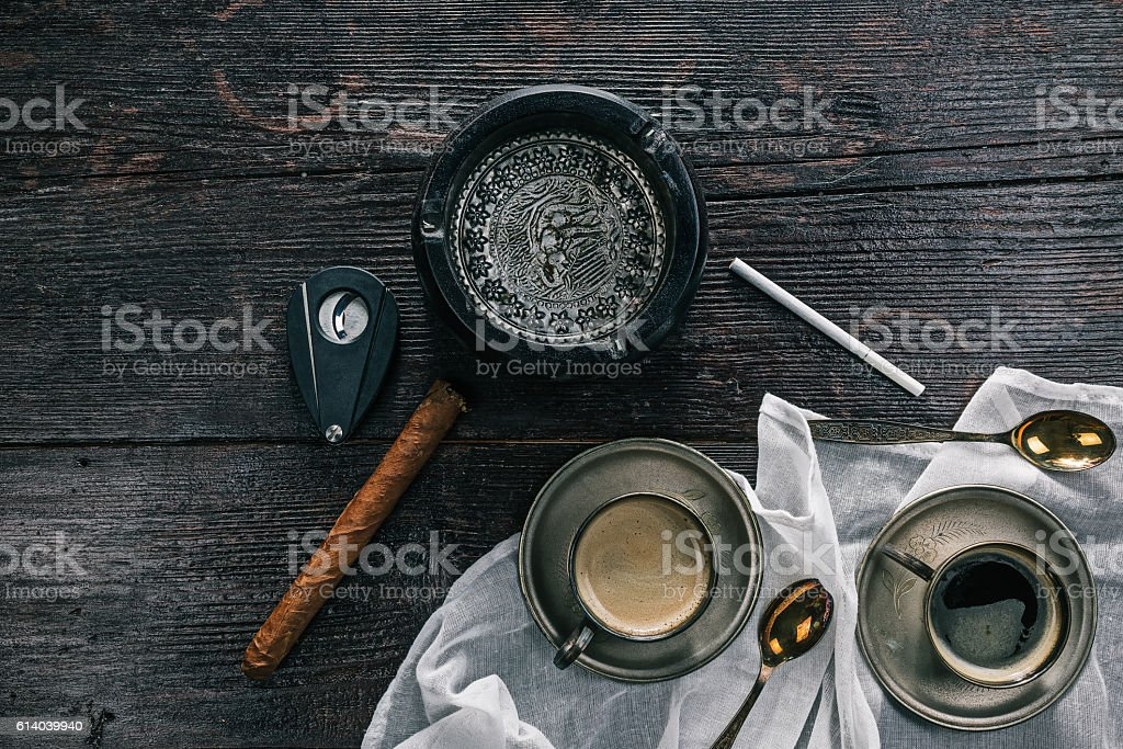 Still life with coffee cups and ashtray - Photo