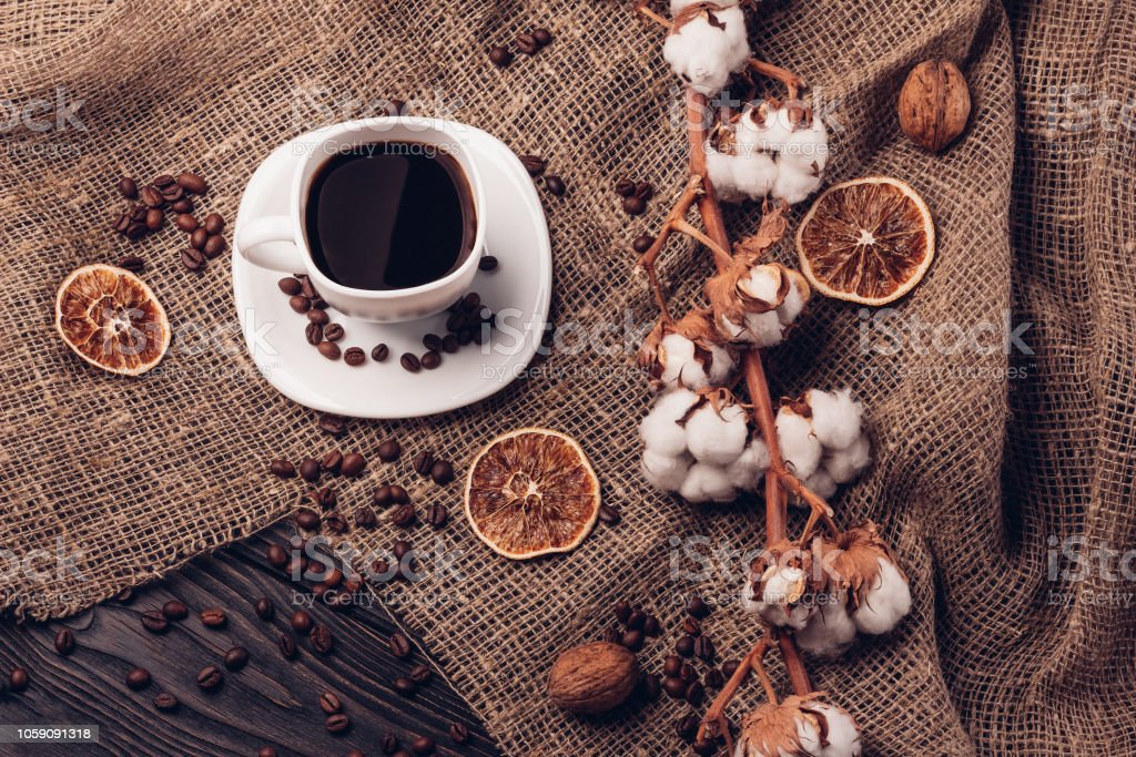 Still life with coffee in a bowl and coffee beans on a table wit stock photo