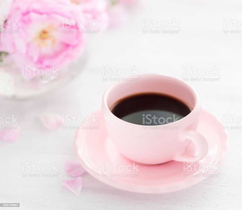 Still life with cup of coffee and  bouquet of roses. Selective focus. Shallow depth of field. stock photo