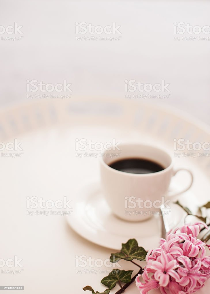 Still life with cup of coffee and flowers