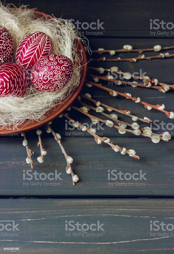 Still life with decorated Easter eggs, on black wooden background stock photo
