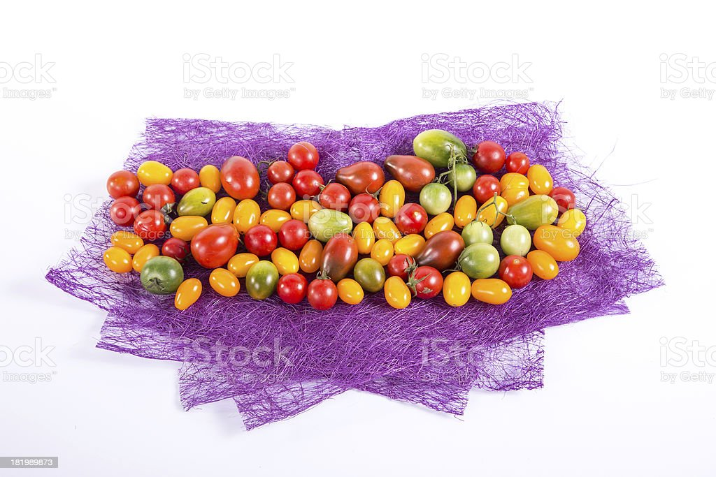 Still life with different color tomatoes royalty-free stock photo