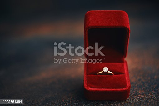 Valentine's Day still life with engagement ring in velvet gift box