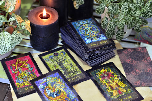 Still life with fantasy tarot cards and black candles. stock photo