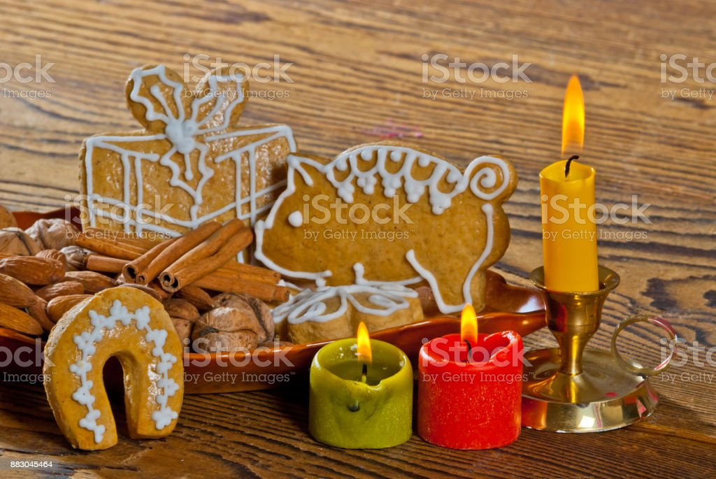 Still Life with Gingerdreads and Flaming Candles stock photo