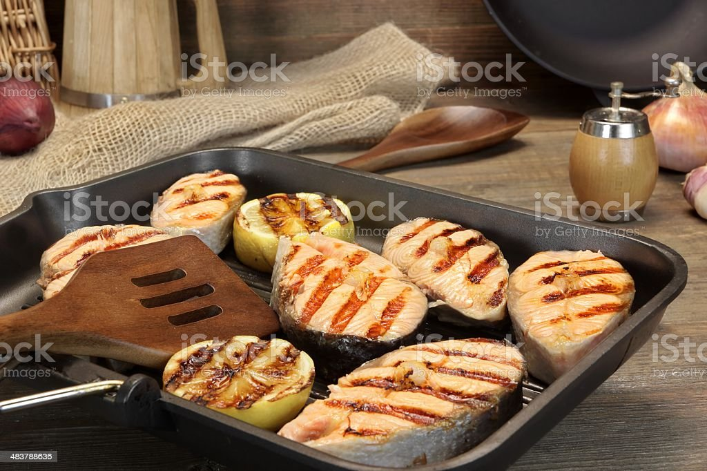 Still Life With Grilled Salmon Steaks In Rustic Style stock photo