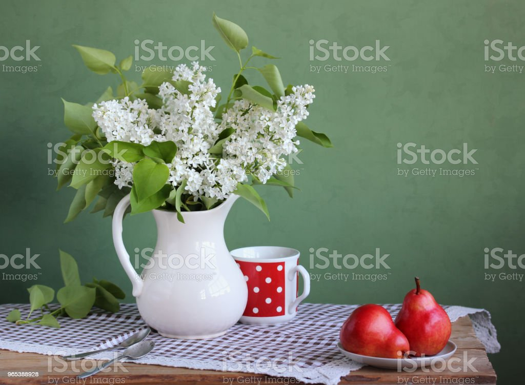 Still life with lilac and pears. royalty-free stock photo