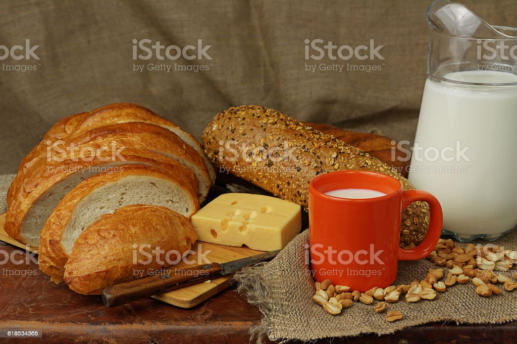 Still life with milk, cheese and bread stock photo