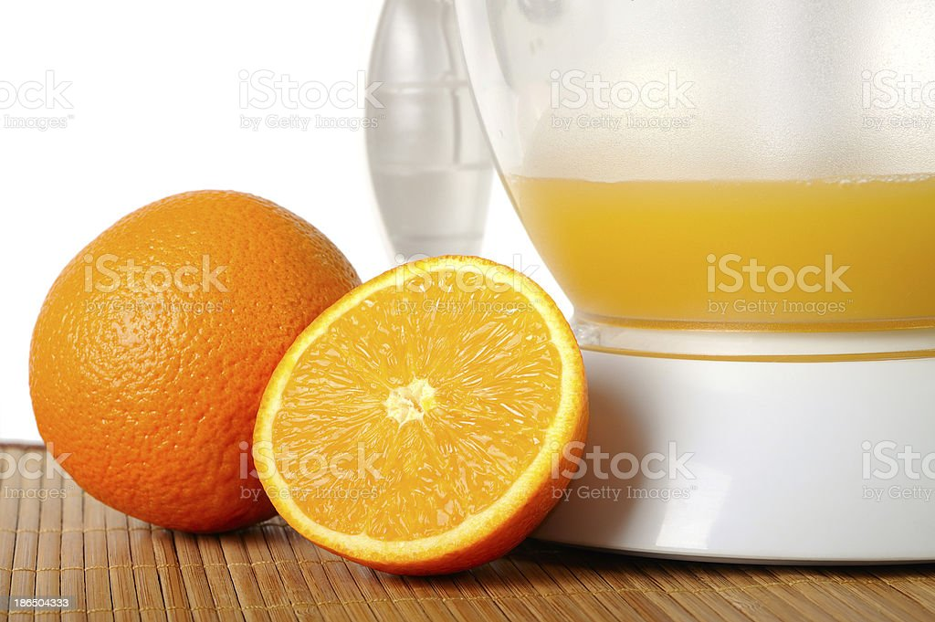 Still life with oranges and a juice extractor royalty-free stock photo