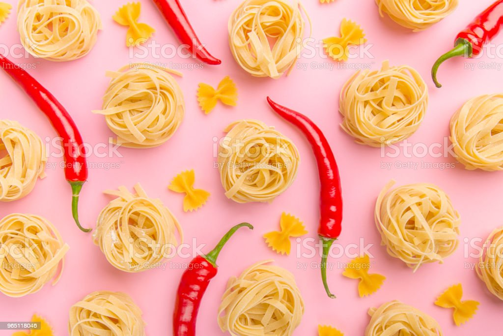 Still life with pasta and red chili peppers zbiór zdjęć royalty-free