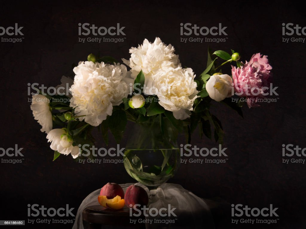 Still life with peonies and necatrines stock photo