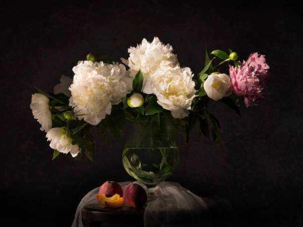still life with peonies and necatrines - vintage flowers stock photos and pictures