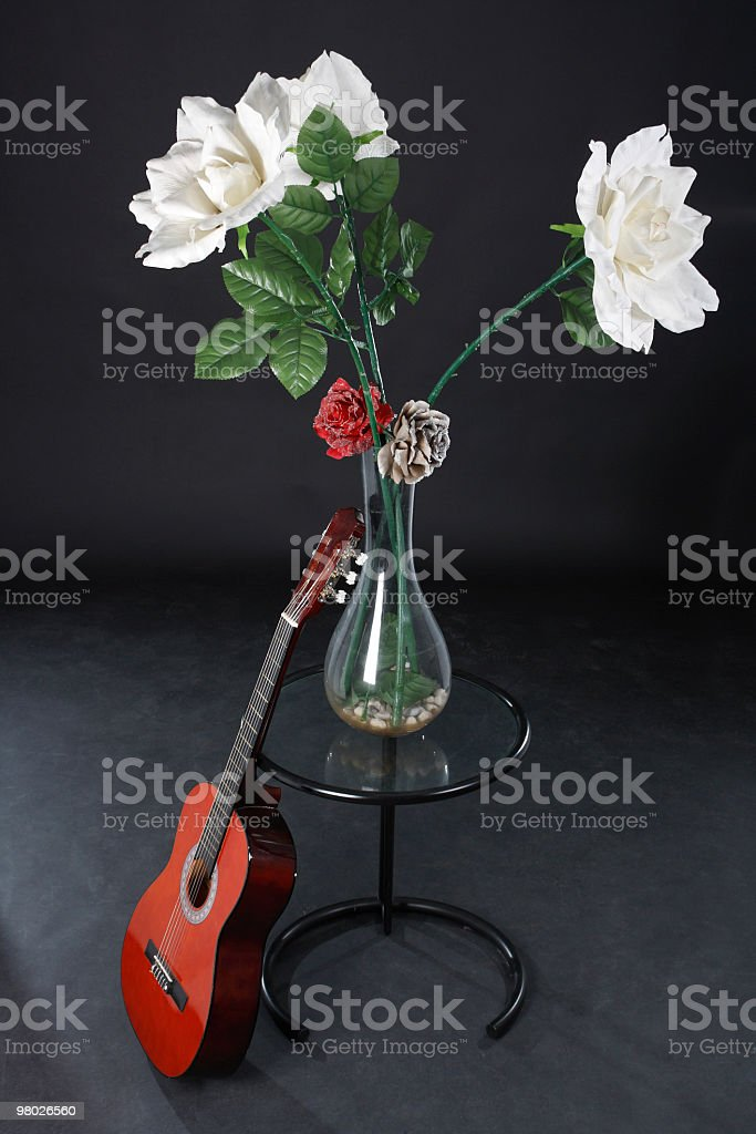 still life with plastic flowers and acoustic guitar royalty-free stock photo