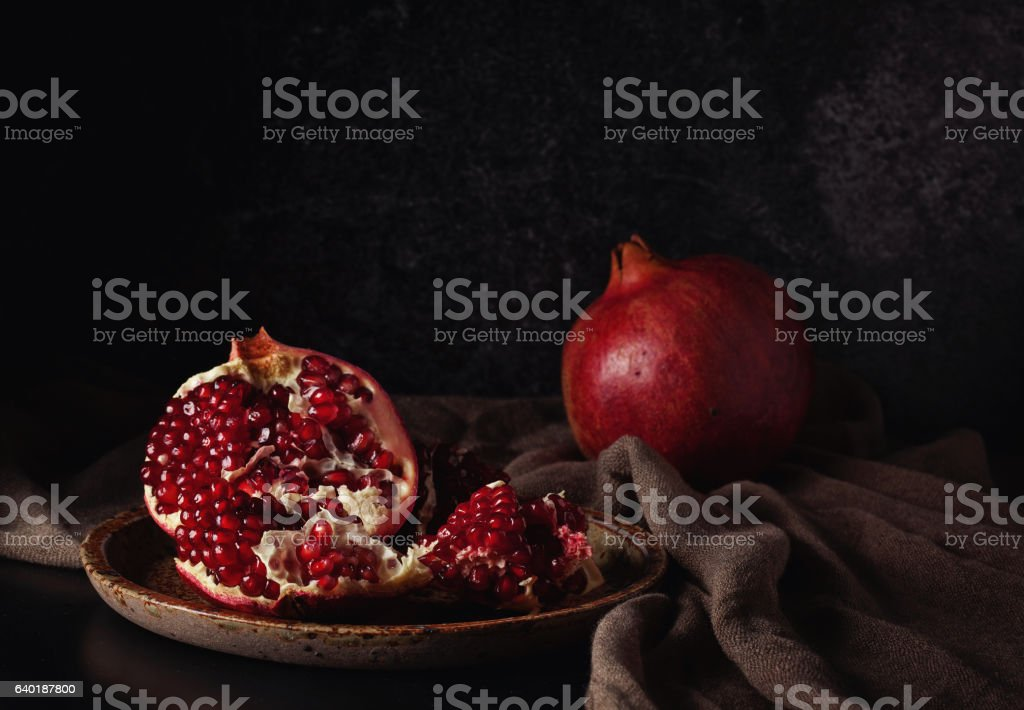 Still life with red juicy pomegranates stock photo