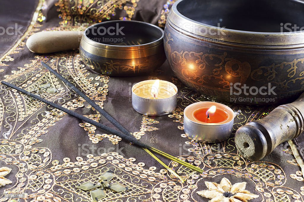 Still life with singing bowls stock photo